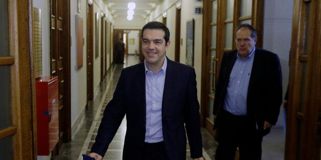 Greece's Prime Minister Alexis Tsipras arrives for an inner meeting at the parliament in Athens on Tuesday,...