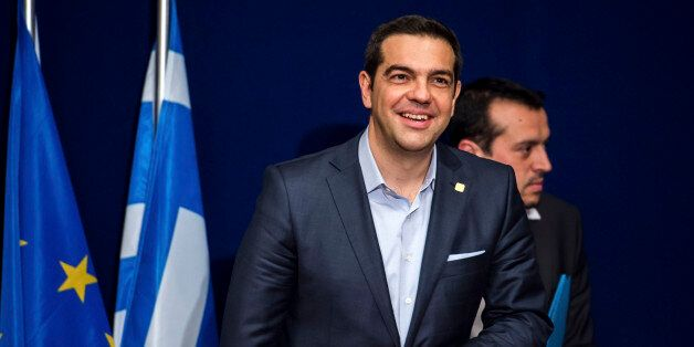 Greek Prime Minister Alexis Tsipras takes his seat during a media conference after an EU summit in Brussels...