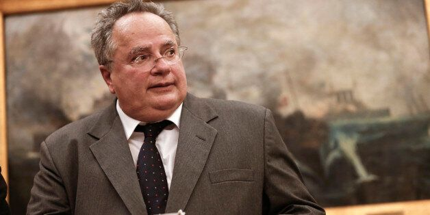 Greece's New Foreign Minister Nikos Kotzias arrives at his new office during a handover ceremony in Athens,...