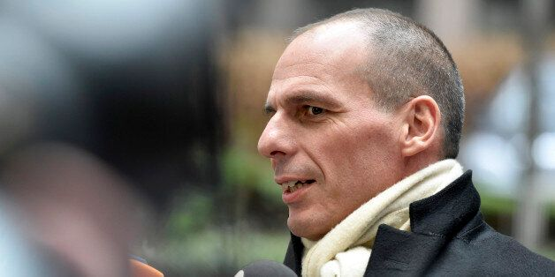 Greek Finance Minister Yanis Varoufakis speaks with the media as he arrives for a meeting of eurogroup...