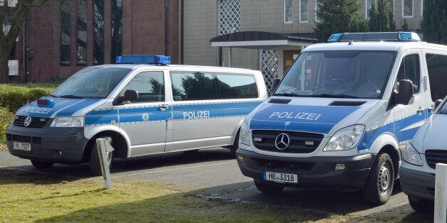 Police cars stand in front of the synagogue in Bremen, Germany, Saturday Feb. 28, 2015. Police in the...