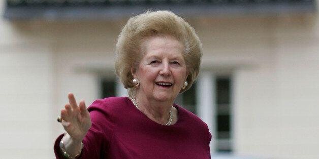 Former British Prime Minister, Margaret Thatcher waves as she arrives back at her home in London, returning...