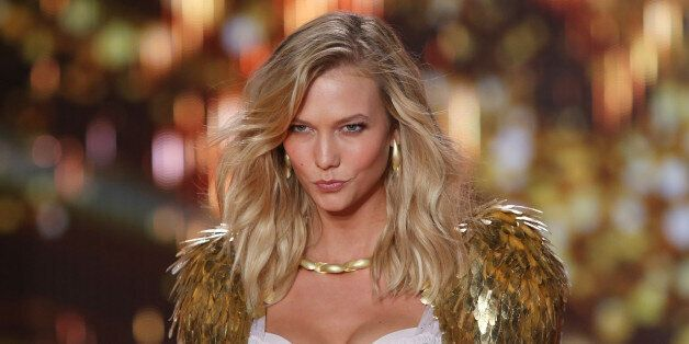 Model Karlie Kloss displays a creation at the Victoria's Secret fashion show in London, Tuesday, Dec....