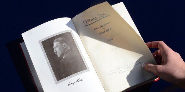 One of two rare copies of 'Mein Kampf' signed by the young Nazi leader Adolf Hitler and due for auction,...