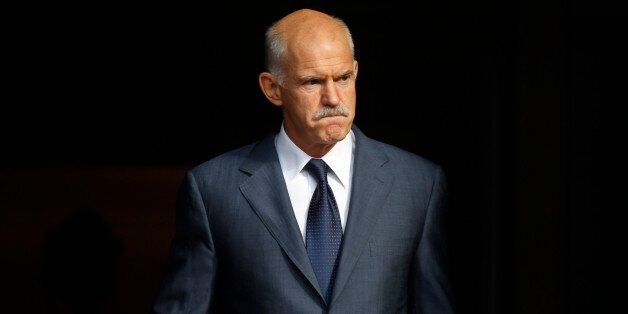 FILE In this Saturday, Oct. 1, 2011, file photo Greece's Prime Minister George Papandreou awaits the...
