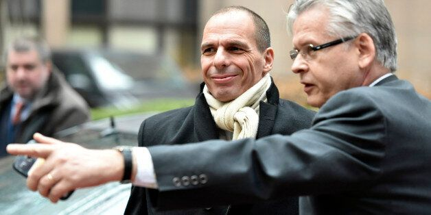 Greek Finance Minister Yanis Varoufakis, center, arrives for a meeting of eurogroup finance ministers...