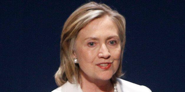 US Secretary of State Hilary Rodham Clinton addressing an international conference promoting democracy...