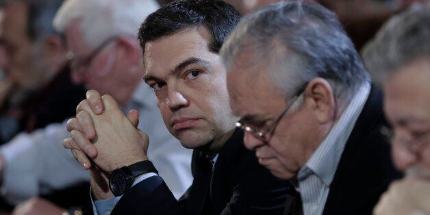 Greek Prime Minister and Syriza leader Alexis Tsipras, third right, looks on at his party central committee,...