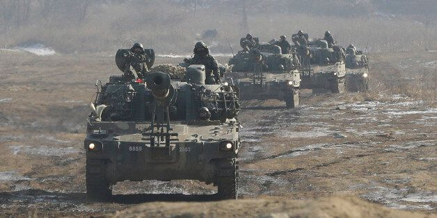 South Korean army K-55 self-propelled artillery vehicles move during a military exercise near the demilitarized...