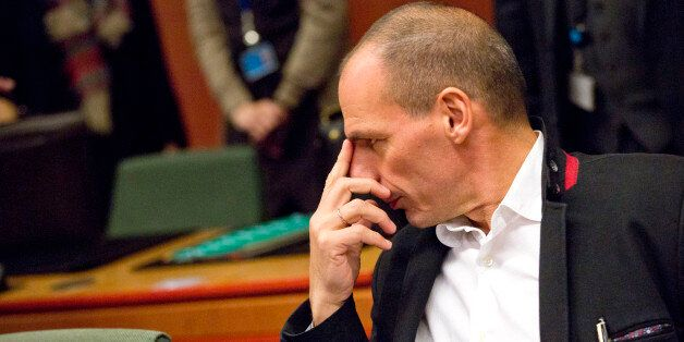Greek Finance Minister Yanis Varoufakis waits for the start of a round table meeting of eurogroup finance...