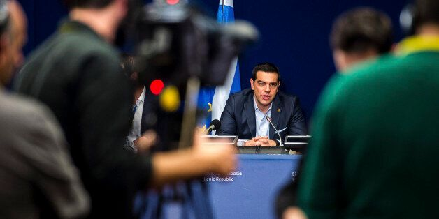 Greek Prime Minister Alexis Tsipras, center, speaks during a media conference after an EU summit in Brussels...