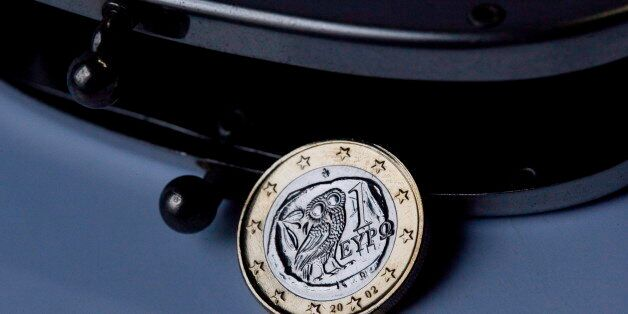 GERMANY, BONN - FEBRUARY 03:Greek 1 Euro coin in an otherwise empty purse. Symbol photo on the topics...