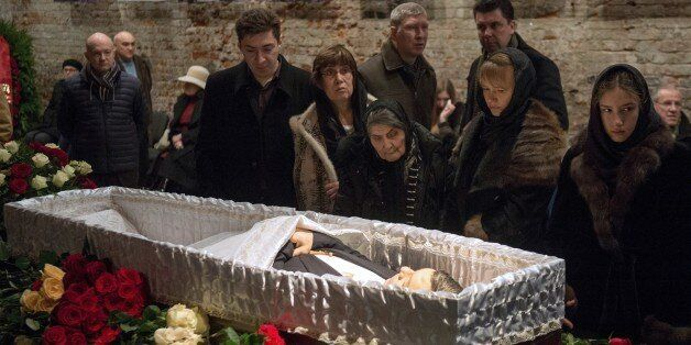 Relatives and friends pay their respects as they stand close to the coffin of Boris Nemtsov during a...