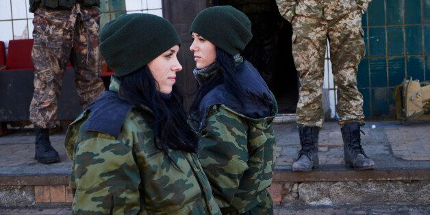 MARIUPOL UKRAINE - FEBRUARY 24: Twins, Anya and Katya, both 19 years and have been with the DPR army...