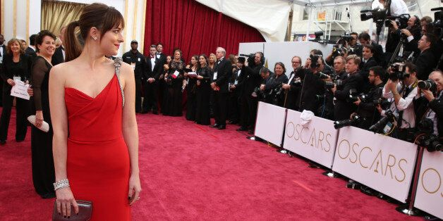 Dakota Johnson arrives at the Oscars on Sunday, Feb. 22, 2015, at the Dolby Theatre in Los Angeles. (Photo...