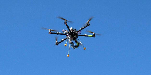 A drone flies at the Abbaye Des-Vaux-de-Cernay, southwest of Paris, Thursday March 20, 2014. French drone...