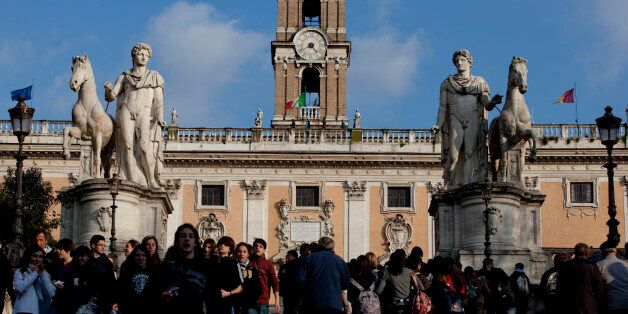 Pedestrians stroll in front of the Capitolium in Rome, Italy, on Monday, March 15, 2010. Italy's economy...