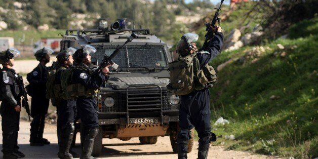RAMALLAH WEST BANK - FEBRUARY 28: Israeli Security Forces use tear gas and plastic bullets against Palestinians...