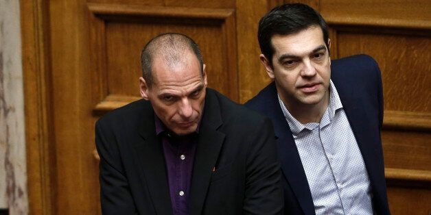 Greek Minister Alexis Tsipras, right and HIS Finance Minister Yanis Varoufakis look on during the vote...
