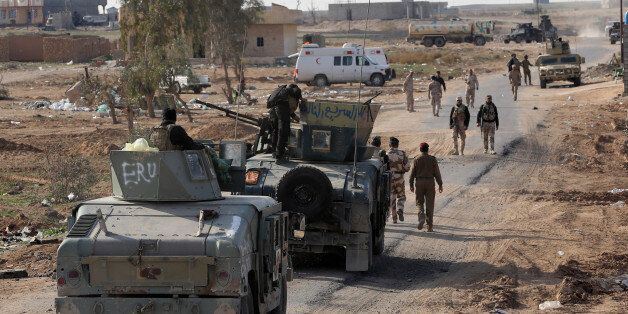 Iraqi security forces are deployed during a military operation to regain control of the villages around...