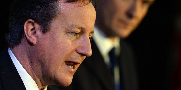 LEEDS, ENGLAND - FEBRUARY 05: Britain's Prime Minister David Cameron (L) and Chancellor Of The Exchequer...