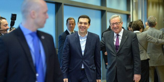 BRUSSELS, BELGIUM - FEBRUARY 04: Greek Prime Minister Alexis Tsipras (C) walks next to European Commission...