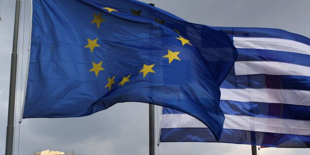 ATHENS, GREECE - FEBRUARY 17: The EU and Greek flags fly in front of the Parthenon on the Acropolis on...