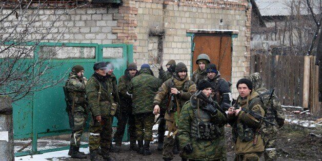 Pro-Russian separatist fighters prepare on February 9, 2015 to go to the frontline near Uglegorsk, 6...