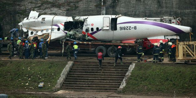 TAIPEI, TAIWAN - FEBRUARY 05:  (CHINA OUT) Emergency workers clear the debris a day after the TransAsia Airways ATR 72-600 turboprop airplane crash on February 5, 2015 in Taipei, Taiwan of China. The plance, caught in dramatic video, crashed into the Keelung River shortly after taking off from Taipei Songshan airport February 4. Thirty-two people are confirmed dead, with 11 still missing. Fifteen people were pulled from the river alive.  (Photo by ChinaFotoPress/ChinaFotoPress via Getty Images)