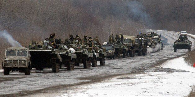 A column of Ukrainian forces roles to Debaltseve as it moves near the eastern Ukrainian town of Artemivsk,...