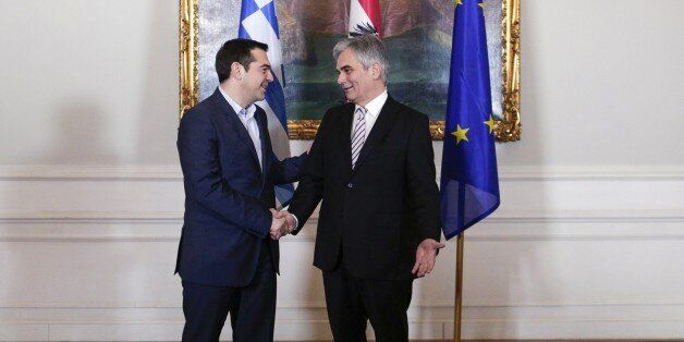 Greek Prime Minister Alexis Tsipras (L) and Austrian Federal Chancellor Werner Faymann shake hands on...