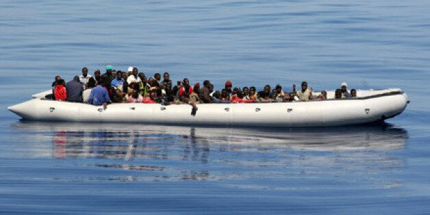 An inflatable hard bottom craft carrying some 87 would be immigrant mainly from Somalia is pictured 26...