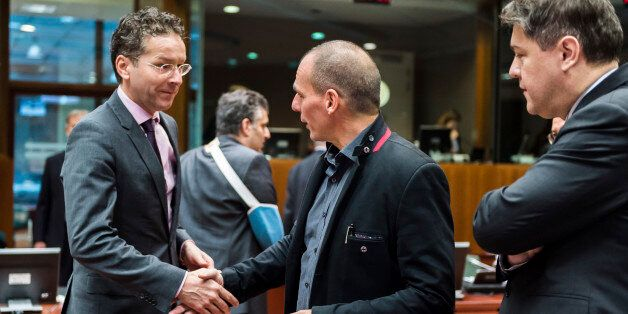 Greece's Finance Minister Yanis Varoufakis, center, greets Dutch Finance Minister Jeroen Dijsselbloem,...