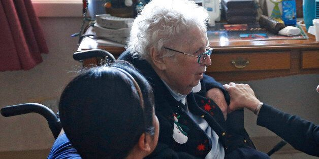 Mother Patricia Mary, right, and nurse Friary Nguyen visit 99-year-old resident Helen Reichenbach in her room at the Mullen Home for the Aged, run by Little Sisters of the Poor, in Denver, Thursday Jan. 2, 2014. Acting at the request of Little Sisters of the Poor, Justice Sonia Sotomayor on Tuesday Dec. 31, 2013, temporarily blocked the Obama administration from forcing some religious-affiliated groups to provide health insurance coverage of birth control or face penalties as part of the Affordable Care Act. The stay was issued just hours before the requirement was to go into effect on New Year's Day. (AP Photo/Brennan Linsley)