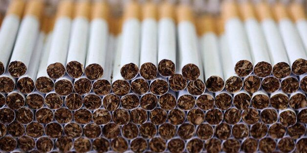 Lambert and Butler cigarettes, manufactured by Imperial Tobacco Group Plc, sit stacked ahead of packaging...