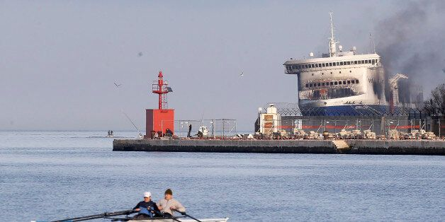 Smoke billows from the Italian-flagged Norman Atlantic ferry after that was towed into the port of Brindisi,...