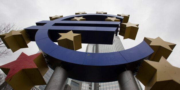 A euro sign sculpture stands in front of the former European Central Bank (ECB) headquarters in Frankfurt,...