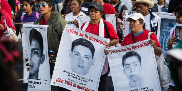 MEXICO CITY, MEXICO - JANUARY 26: Relatives of the missing students, attend a protest for the 43 missing...