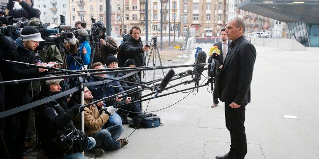 Greek Finance Minister Yanis Varoufakis speaks to journalists after a meeting with the President of the...
