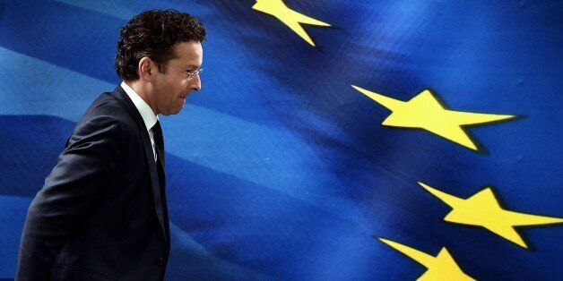 Eurogroup chairman Jeroen Dijsselbloem leaves after a press conference with the Greek Finance Minister...