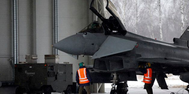 Italy's Eurofighter Typhoon jet fighter prepares for take off during NATO's Baltic Air Policing Mission...