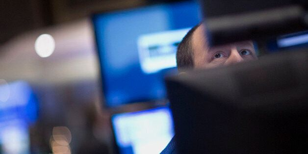 A trader works on the floor of the New York Stock Exchange (NYSE) in New York, U.S., on Friday, Jan....