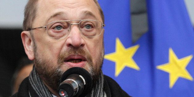 European Parliament President Martin Schulz shows a sticker that reads: 'Je suis Charlie (I Am Charlie)',...