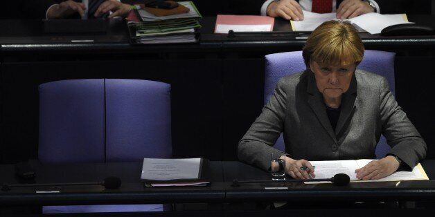 German Chancellor Angela Merkel attends a session of the Bundestag (German lower house of parliament)...