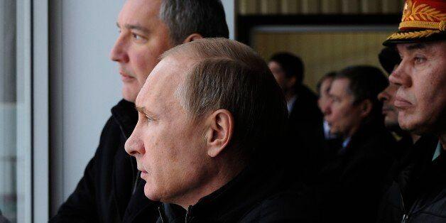 Russian President Vladimir Putin, centre visits the Central Scientific Research Institute of Precise...