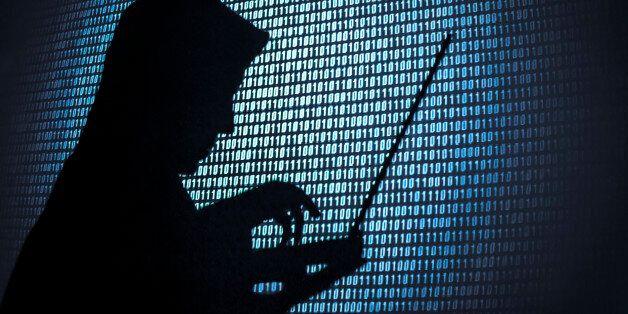 Computer hacker silhouette. Blue binary code background. Seattle