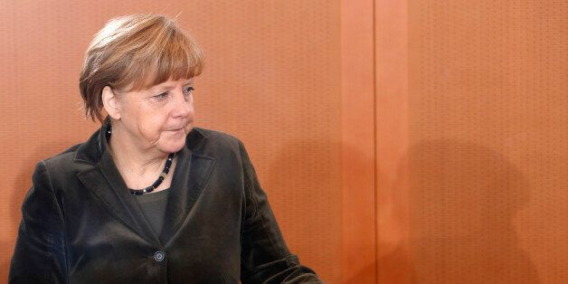 German Chancellor Angela Merkel arrives for the weekly cabinet meeting in Berlin Wednesday, Feb. 4, 2015....