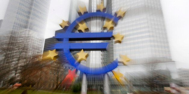 In this zoomed picture the Euro sculpture stands in front of the old European Central Bank in Frankfurt,...