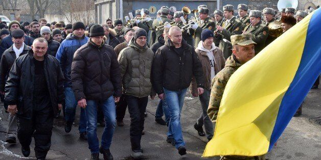 Column of reservists, called up to participate in the fighting in the east of Ukraine, march during a...