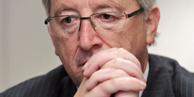 Jean-Claude Juncker, Luxembourg's prime minister and president of the Eurogroup, pauses during a press...